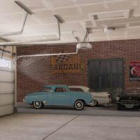 Pared de garaje decorada con coches clásicos americanos