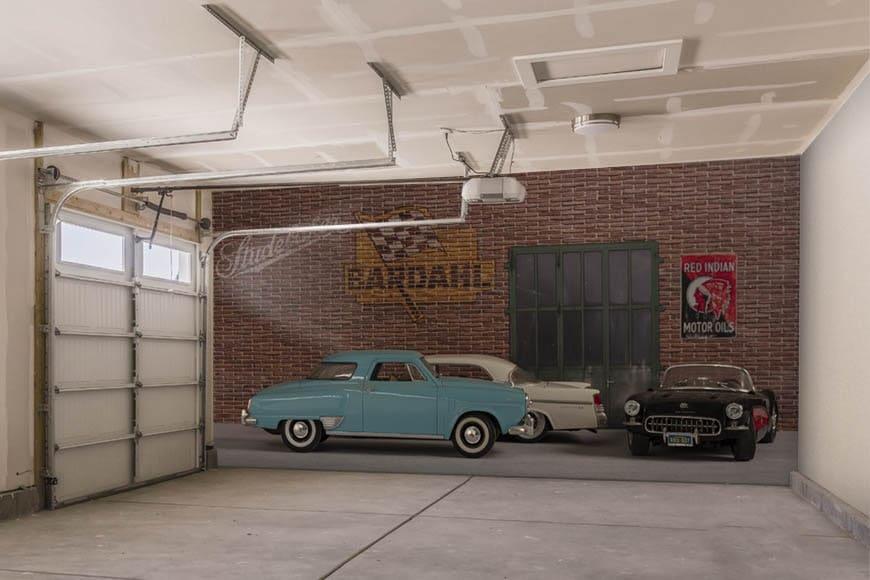 Pared de garaje con una escena simulada con coches americanos en un espacio vintage